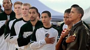 president barack obama uss aircraft carrier ncaa basketball game